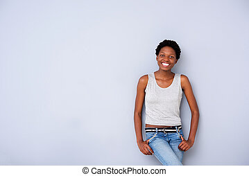 cool african american female model posing on gray wall
