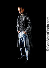Portrait of cool latino man isolated on black