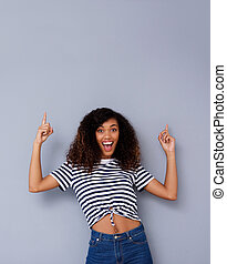 cool young black woman pointing up