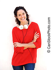 cool young woman with headphones against white background
