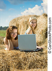 girls with notebook in farm