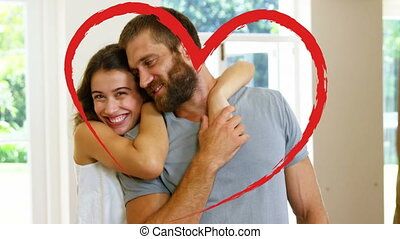 Portrait of couple cuddling at home for valentine day
