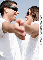 Portrait of couple holding hands