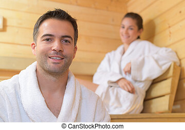 Portrait of couple in sauna