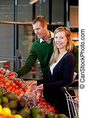 Portrait of Couple in Supermarket