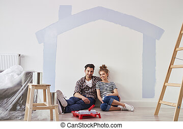 Portrait of couple in their new home