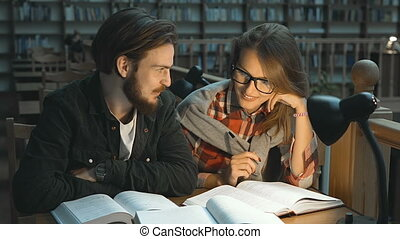 Portrait of Couple of Students in Library