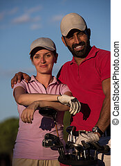 portrait of couple on golf course - portrait of happy young ...