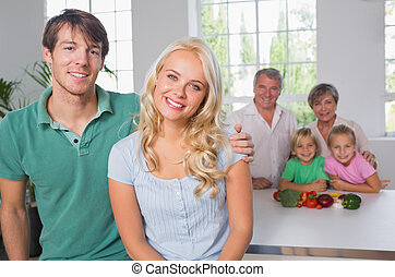 Portrait of couple with their family