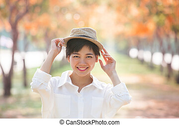 portrait of couples beautiful asian woman standing in blooming f