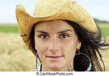 Portrait of cowgirl with hint of a smile