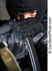 Portrait of criminal with a gun