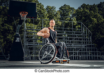 Portrait of cripple basketball player in wheelchair.