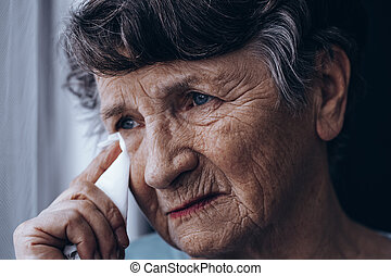 Portrait of crying senior