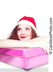portrait of curly girl as Santa with a gift