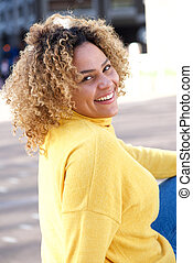 curvy african american woman sitting outside