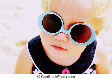 Portrait of cute 1,5 years old baby with fashion vintage sunglasses