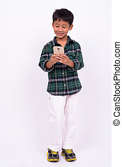 Portrait of cute Asian boy using phone