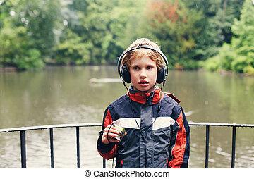 Portrait of cute autistic boy with headphones