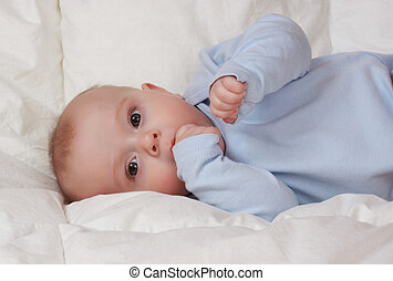 cute baby boy - portrait of cute baby boy on white blanket