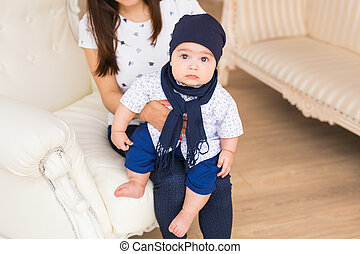 Portrait of cute baby boy wearing blue hat.