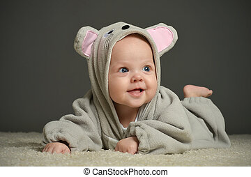 Portrait of cute baby in mouse costume