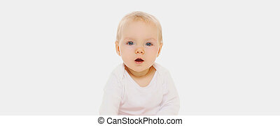 Portrait of cute baby looking at camera on a white background