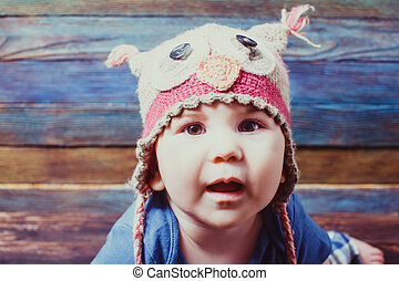 Portrait of cute baby wearing funny hat.