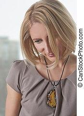 portrait of cute blond woman smiling
