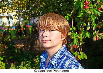 portrait of cute boy in leaves