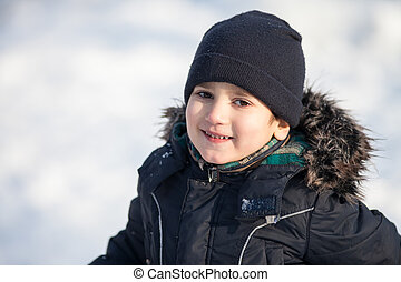 boy in the winter park