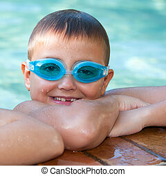Portrait of cute boy with swim goggles.