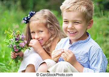 Portrait of cute children with flowers