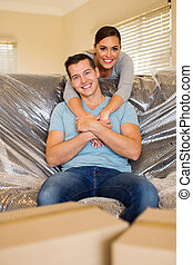 couple relaxing at new home