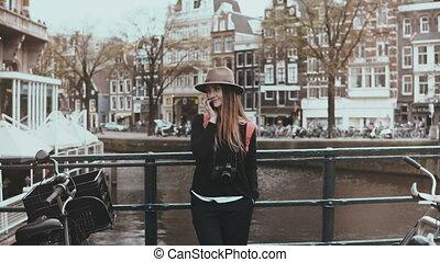 Portrait of cute European female make phone call. Zoom in....
