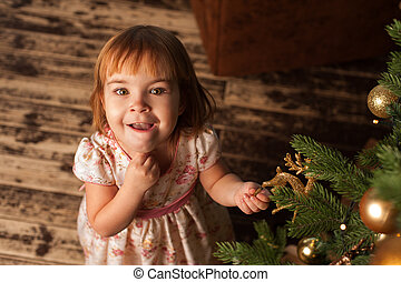 Portrait of cute girl decorating Christmas tree