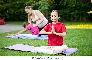 cute girl doing yoga during outdoor lesson at park