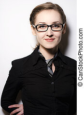 Portrait of cute girl in glasses on a light background