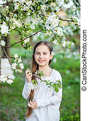 Portrait of cute girl in the spring garden