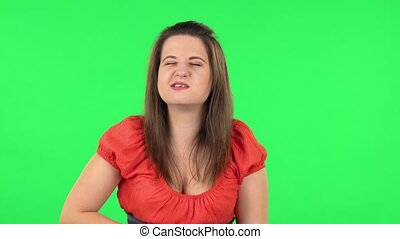 Portrait of cute girl is feeling very bad, her stomach hurting . Green screen