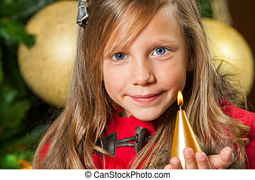 Portrait of cute girl with candle.