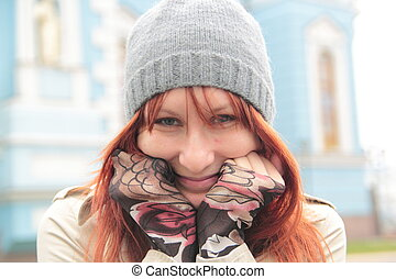 Portrait of cute girl with red hair in hat outdoor