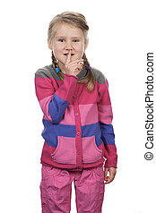 Portrait of cute girl with silence gesture