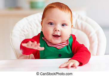 portrait of cute infant baby boy in elf costume sitting in highchair  sc 1 st  Can Stock Photo & Cute infant redhead baby boy in elf costume playing with red star in ...
