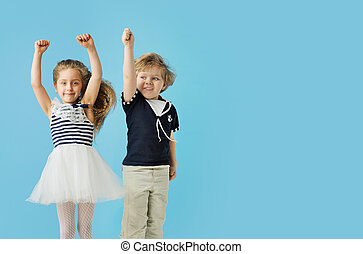 Portrait of cute jumping kids