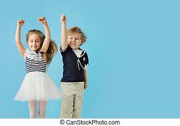 Portrait of cute jumping kids
