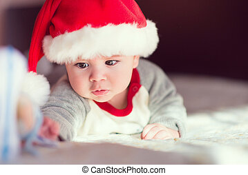 Portrait of cute little baby in red  Santa Claus hat