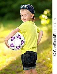 Portrait of cute little boy  in summer