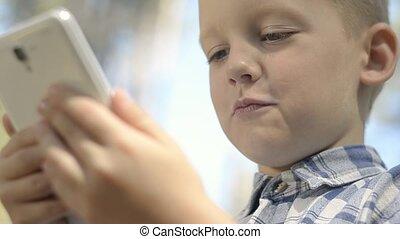 Portrait Of Cute Little Boy Using D