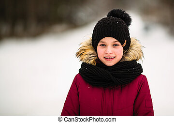 Portrait of cute little girl outdoor at winter.